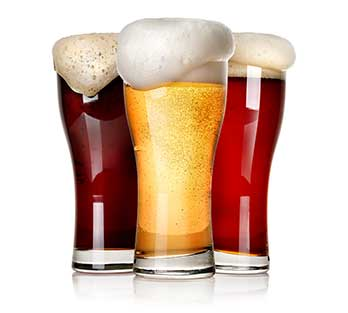 Frothy craft beer in glass tumblers