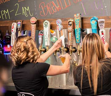 Craft beer taps behind the bar